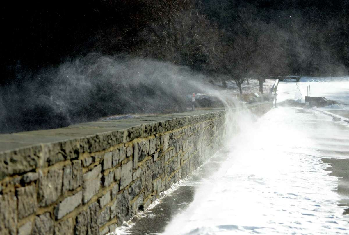 Spindrift is whipped over the outlook at John Boyd Thacher State Park Monday afternoon, Jan. 18, 2016, in New Scotland, N.Y. (Will Waldron/Times Union)