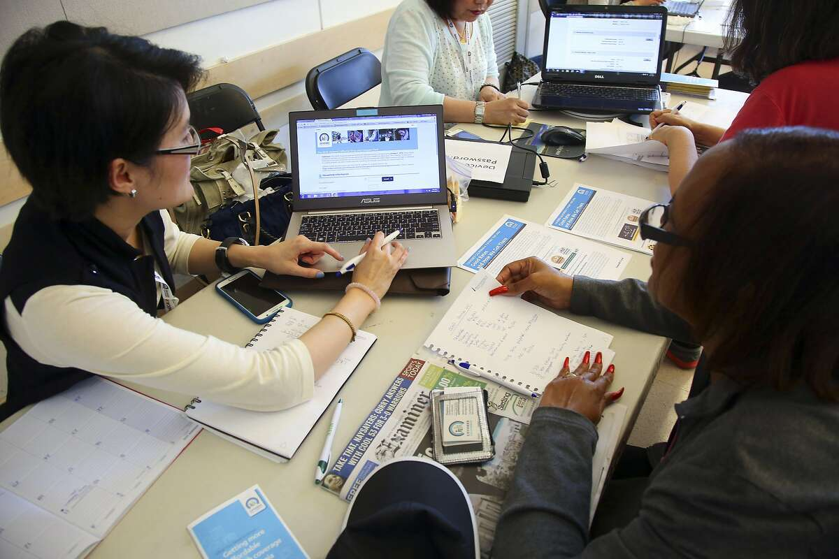 People sign up for health insurance through the Affordable Care Act in San Francisco in 2015.