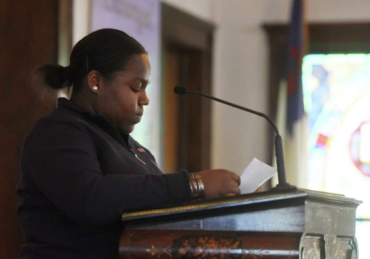 """Shauntel Hylton, 17, recites her speech during the Fourth Annual the Rev. Dr. Martin Luther King Jr. Oratorical Contest at First Baptist Church in Greenwich, Conn. Monday, Jan. 18, 2016. Participants responded to Dr. King's statement """"A riot is the language of the unheard,"""" relating that quote to the context of today's society."""