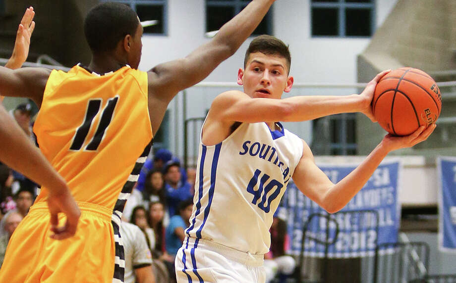 South San's Curtis Allen (right) looks to pass the ball by East Central's Greg White during the second half of their game at the Durbon Center on Jan. 30, 2015. Photo: Marvin Pfeiffer /San Antonio Express-News / Express-News 2015