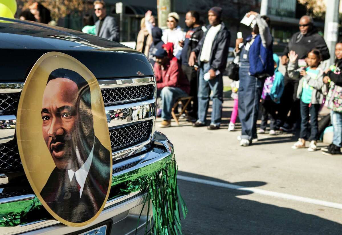 An image of Martin Luther King, Jr., is shown on a truck driving along the route of the 22nd Annual MLK Grande Parade on Monday, Jan. 18, 2016, in Houston.
