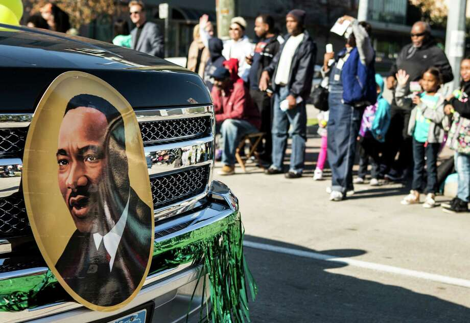 An image of Martin Luther King, Jr., is shown on a truck driving along the route of the 22nd Annual MLK Grande Parade on Monday, Jan. 18, 2016, in Houston. Photo: Brett Coomer, Houston Chronicle / © 2016 Houston Chronicle