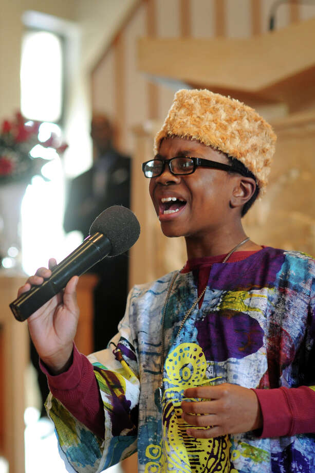 Ajibola Tajadeen, age 11 of Bridgeport, sings during the annual memorial service honoring Dr. Martin Luther King Jr. at St. Paul Missionary Baptist Church in Bridgeport, Conn. Jan. 18, 2016. Photo: Ned Gerard, Hearst Connecticut Media / Connecticut Post
