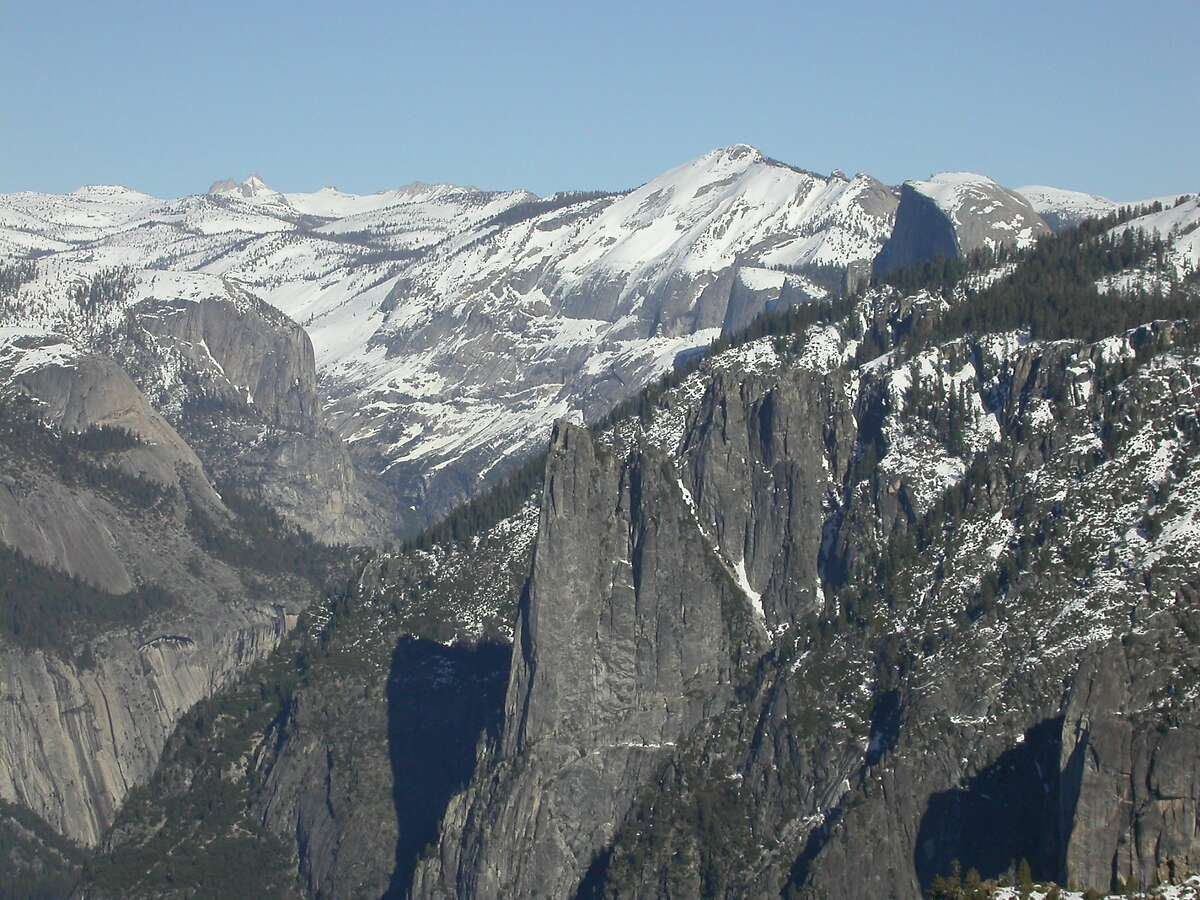 From Badger Pass, 3.5-mile walk, one-way, leads to Dewey Point overlooking Yosemite Valley, Cathedral Rocks, Half Dome and miles across high-country wilderness panorama