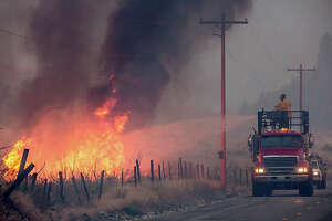 NOAA — Western and Alaskan Wildfires in Summer-Fall:  Wildfires burned over 10.1 million acres across the U.S. in 2015, surpassing 2006 for the highest annual total of U.S. acreage burned since record-keeping began in 1960. The most costly wildfires occurred in California where over 2,500 structures were destroyed due to the Valley and Butte wildfires with the insured losses alone exceeding $1.0 billion. The most extensive wildfires occurred in Alaska where over 5 million acres burned within the state. There was extensive burnt acreage across other western states, most notably (OR, WA, ID, MT, ND, CO, WY, TX).	  Photo: A makeshift fire truck puts water on a wildfire, which is part of the Okanogan Complex, as it burns through brush on August 22, 2015 near Omak, Washington. The fires have burned more tha 127,000 acres. (Photo by Stephen Brashear/Getty Images)