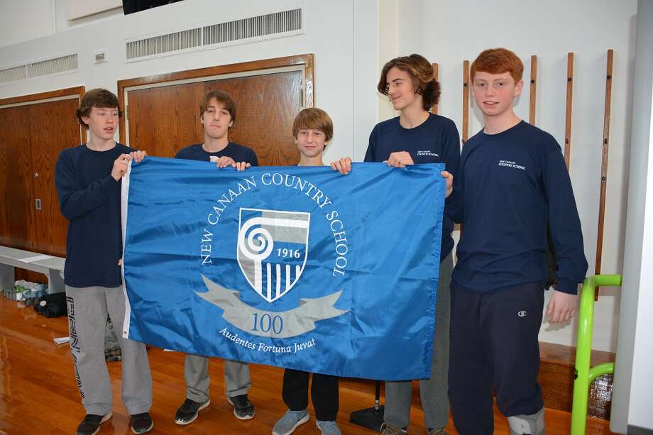 Ninth-graders from the New Canaan Country School with the new school flag they presented on the occasion of the school's100-year anniversary. Pictured from left are Tucker Stoops of Darien, Grady Norton of Stamford, Turner Ives of New Canaan, Harry DeLana of Norwalk and Quinn Galante of Darien. Photo: Contributed Photo