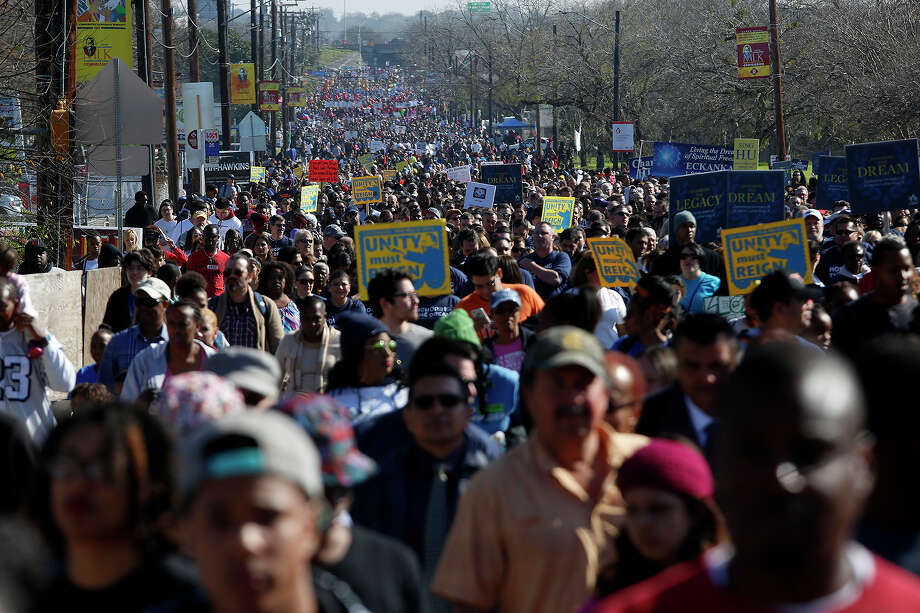 Thousands of participants walk west on Martin Luther King Jr. Drive during the Martin Luther King Jr. Day March on Monday, Jan. 18, 2016. Photo: Lisa Krantz, San Antonio Express-News / ©2015 San Antonio Express-News