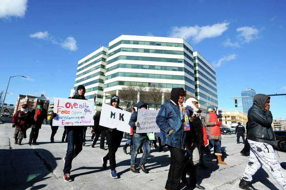 More than 300 people participated in Stamford's Martin Luther King, Jr. march on Monday, which wove through downtown Stamford and past the Government Center. Photo: Michael Cummo / Hearst Connecticut Media / Stamford Advocate