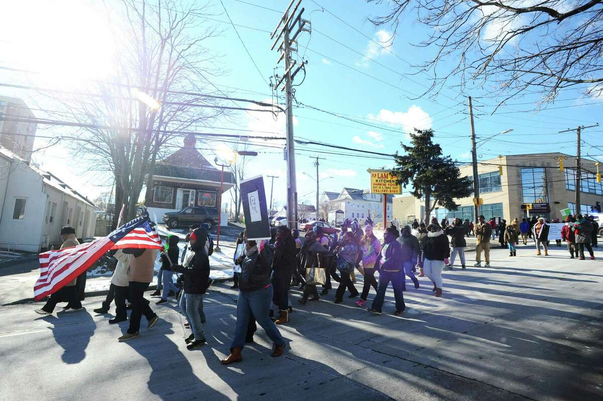 The annual Stamford Martin Luther King, Jr. march began at Bethel AME Church and snaked through downtown before finishing at the Yerwood Center on Monday morning, Jan. 18, 2016. More than 300 people participated in the peaceful march which was held after the annual MLK praise rally at the church.