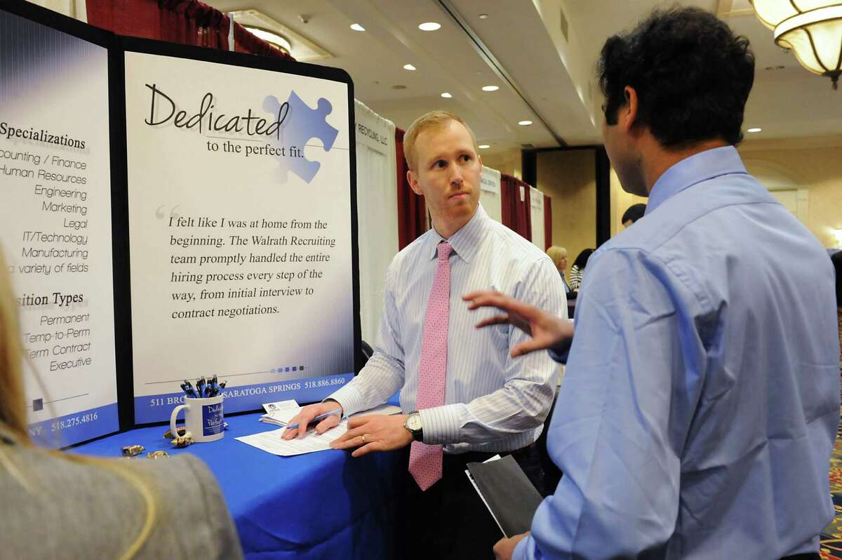 David Jadin of Walrath Recruiting Inc., left, talks to potential employee Srikanth Naik during the Times Union job fair at the Albany Marriott hotel on Monday, Jan. 18, 2016 in Colonie, N.Y. (Lori Van Buren / Times Union)