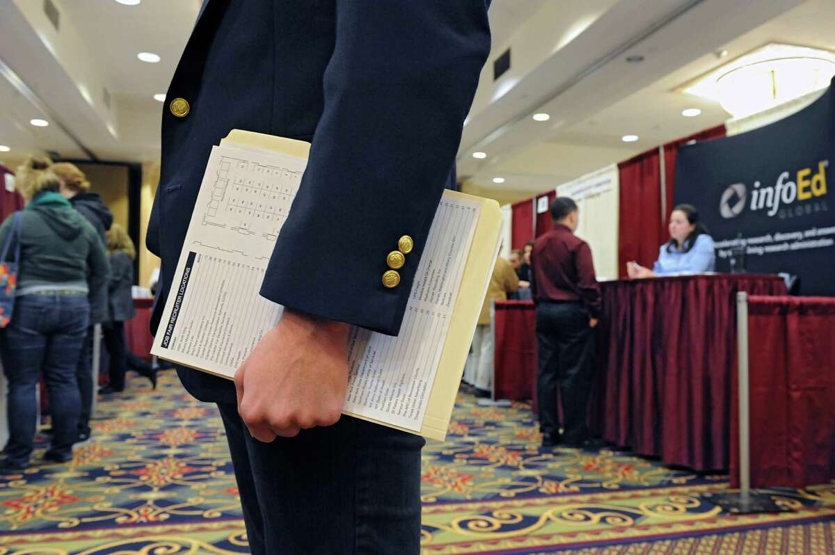Job seekers talk to recruiters during the Times Union job fair at the Albany Marriott hotel on Monday, Jan. 18, 2016 in Colonie, N.Y. (Lori Van Buren / Times Union)