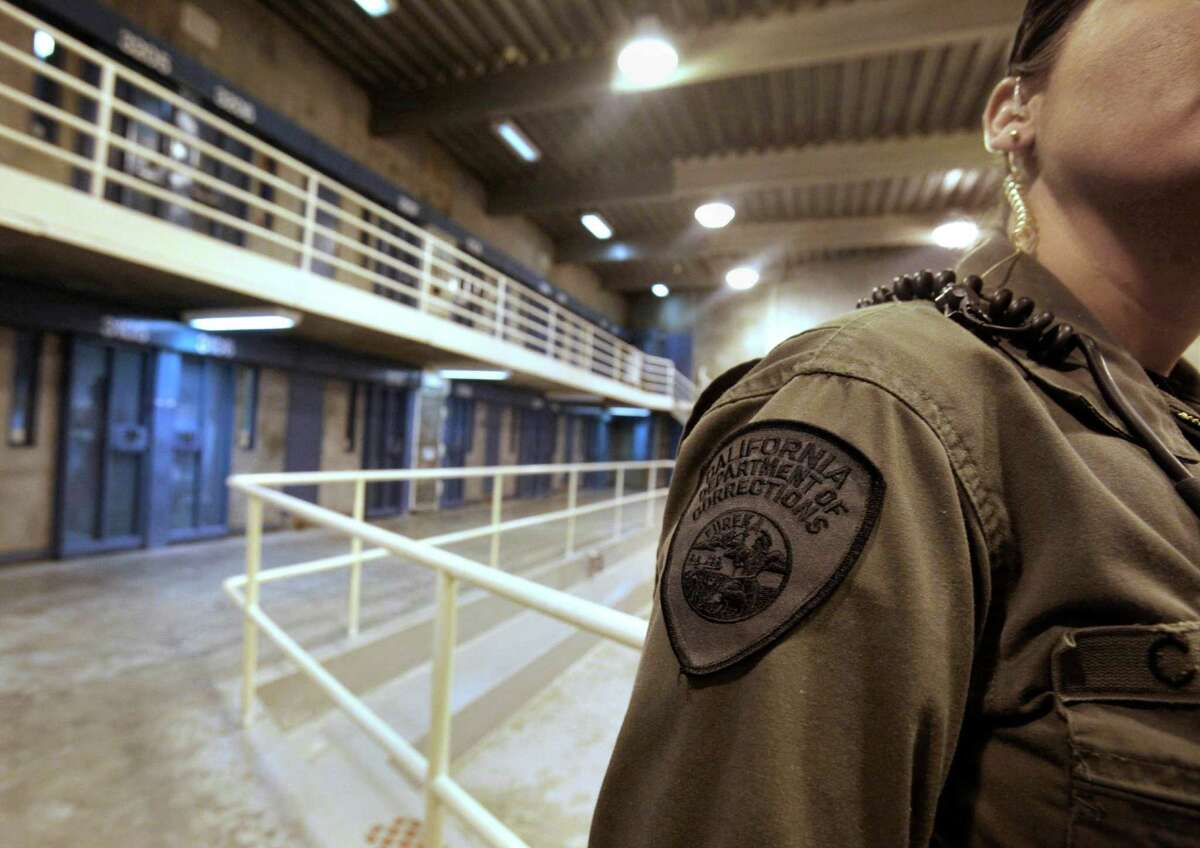 FILE - In this Aug. 17, 2011 file photo, a correctional officer is seen in one of the housing units at Pelican Bay State Prison near Crescent City, Calif.