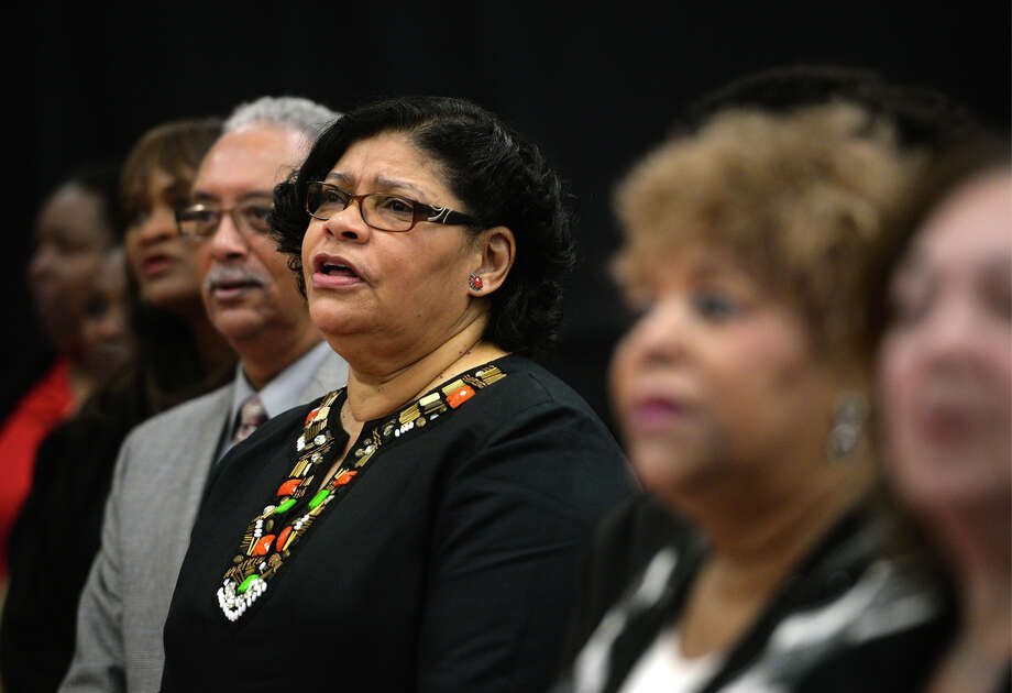 "Mary Ford, center, and Dallas Ford, to her right, sing ""Lift Every Voice and Sing"" during the Dr. Martin Luther King Jr. Brunch at the Robert A. ""Bob"" Bowers Civic Center in Port Arthur on Monday.  