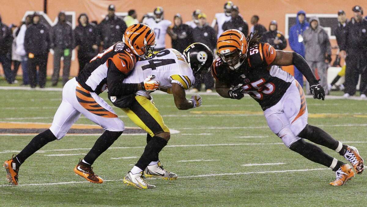 FILE - In this Jan. 10, 2016, file photo, Cincinnati Bengals' Vontaze Burfict (55), right, runs into Pittsburgh Steelers' Antonio Brown (84) during the second half of an NFL wild-card playoff football game in Cincinnati. Burfict was called for a penalty on the play. The Steelers have ruled out All-Pro wide receiver Antonio Brown from Sunday's AFC divisional playoff game against Denver while he recovers from a concussion. Brown left last weekend's wild-card win over Cincinnati after taking a shot to the head from Bengals linebacker Vontaze Burfict. (AP Photo/John Minchillo, File) ORG XMIT: NY190
