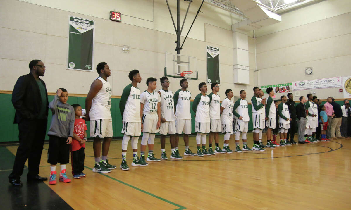 Coach Jamil Hood Sr., left, and his team line up before facing Middletown during Monday's matchup at Green Tech High Charter School in Albany January 18, 2016. (Ed Burke / Special to the Times Union)