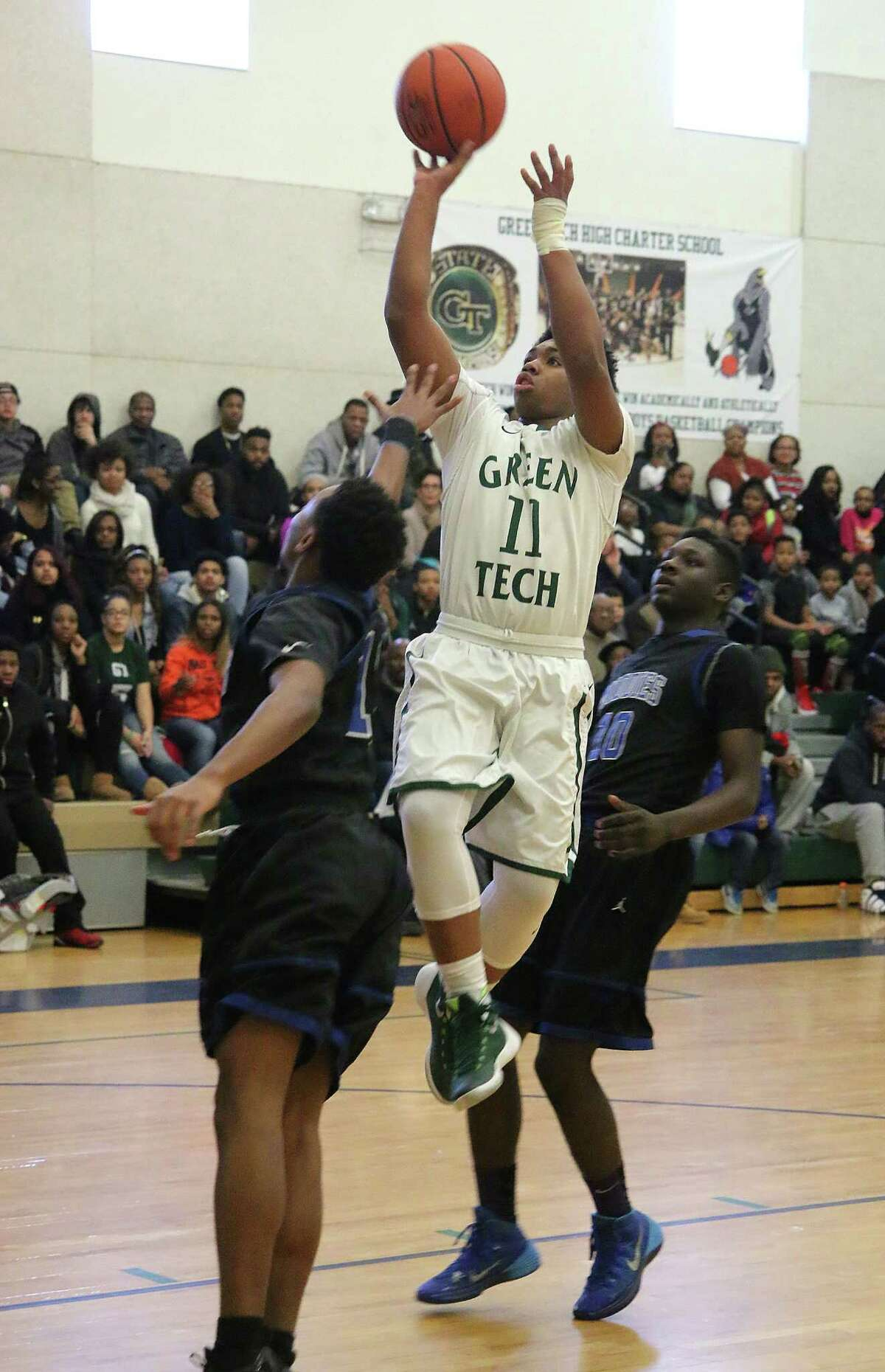 Marcus Friend goes up for two during Monday's varsity basketball matchup against Middletown at Green Tech High Charter School in Albany January 18, 2016. (Ed Burke / Special to the Times Union)