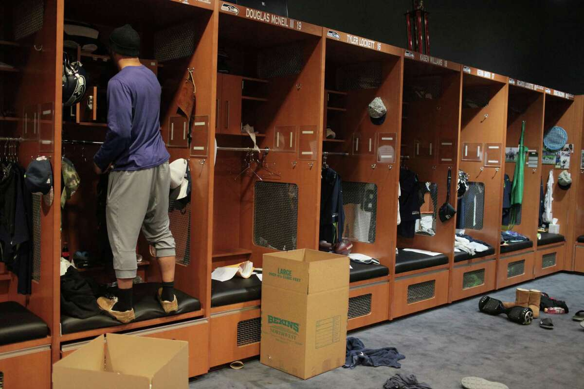 Seattle Seahawks wide receiver Jermaine Kearse packs up his jerseys and other items at his space in the team locker room, Monday, Jan. 18, 2016, in Renton, Wash. The Seahawks' season ended Sunday, Jan. 17, 2016, with a loss to the Carolina Panthers in an NFL football divisional playoff game.