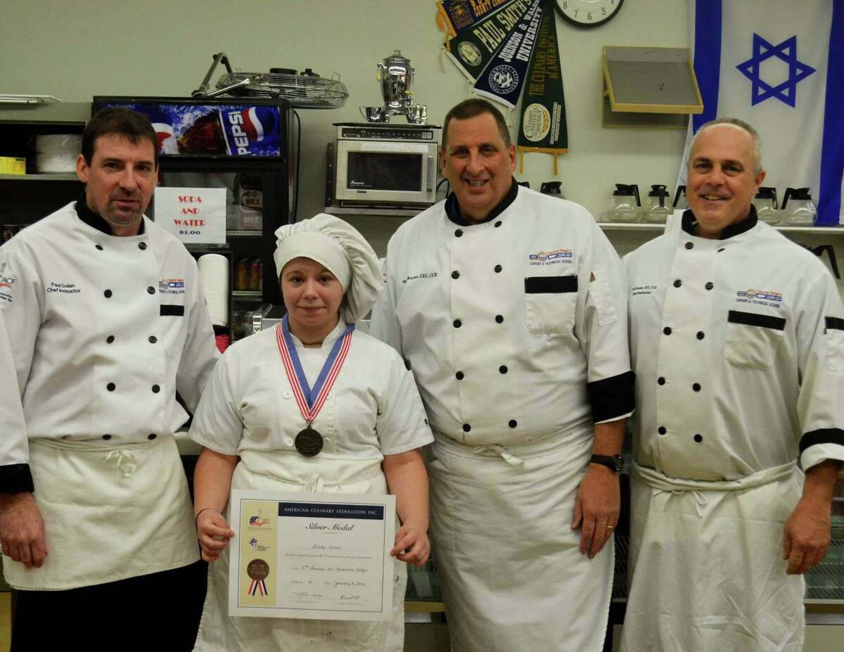 Three Capital Region BOCES Career and Technical School culinary teachers and one of their students, an aspiring chef from the Scotia-Glenville schools, brought home a silver medal this weekend during a culinary competition at Skidmore College. Ashley Nichols was selected to work with CTE chefs Paul Rother, Paul Dolan and Mark Brucker during the fifth annual Skidmore College Culinary Conference and Competition. Shown here are Dolan, Nichols, Brucker and Rother.