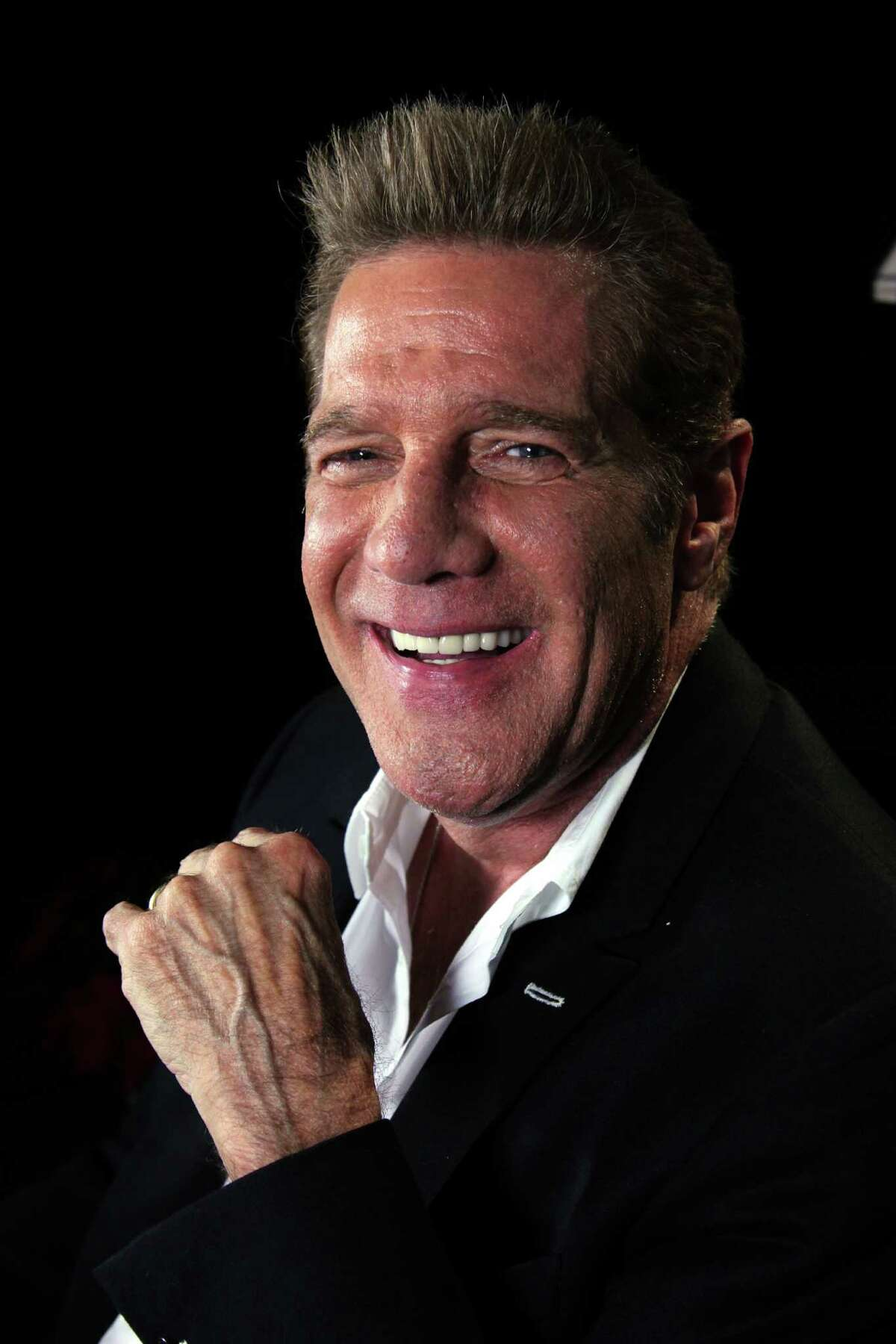 FILE - In this May 7, 2012, photo photo, musician Glenn Frey smiles in New York. Frey, who co-founded the Eagles and with Don Henley became one of history's most successful songwriting teams with such hits as