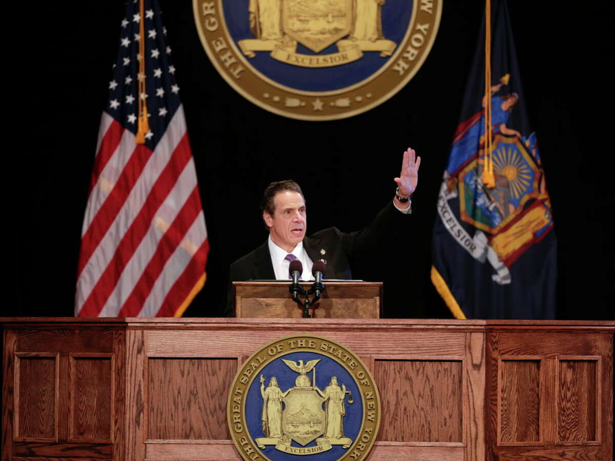 FILE- In this Jan. 13, 2016 file photo, New York Gov. Andrew Cuomo delivers his State of the State address and executive budget proposal at the Empire State Plaza Convention Center in Albany, N.Y. Cuomo's promising to inject billions into upstate roads, add a third railroad line on Long Island, overhaul Penn Station, freeze Thruway tolls and give small businesses a tax break, but a close look at the governor's expensive-sounding promises shows that many aren't as costly as they appear, relying on federal and private money and user fees.(AP Photo/Mike Groll, File) ORG XMIT: NYMG203