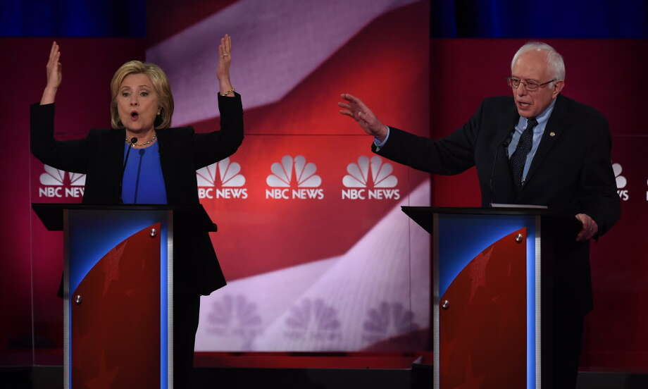 Democratic presidential hopefuls Hillary Clinton and Bernie Sanders participate in the NBC News -YouTube Democratic Candidates Debate on January 17, 2016 at the Gaillard Center in Charleston, SC.  Photo: TIMOTHY A. CLARY / AFP
