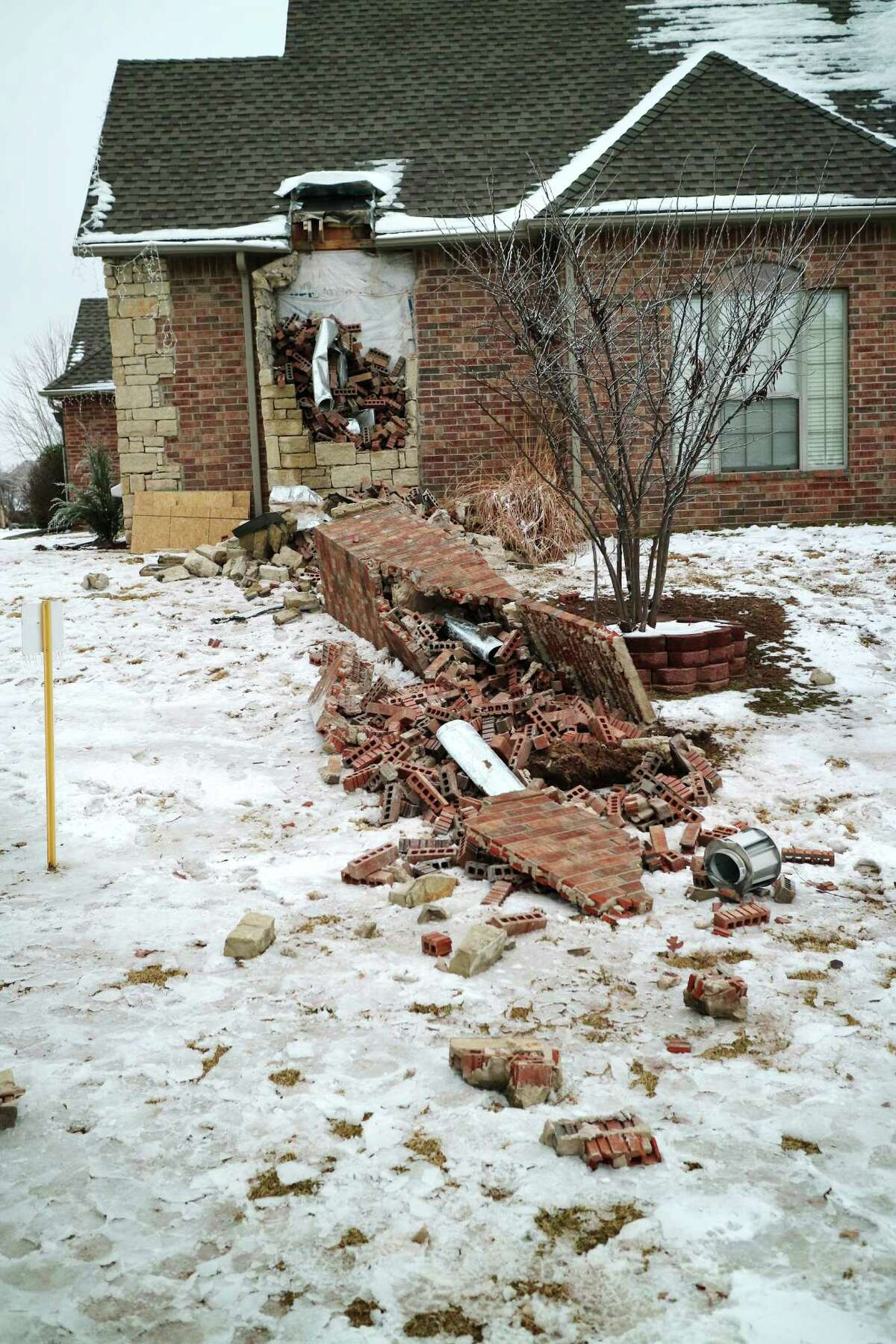 In this Dec. 29, 2015 photo, remains of a collapsed chimney rest on the ground outside a home in Edmond, Okla., following an earthquake. In Oklahoma, now the country?'s earthquake capital, people are talking nervously about the big one as man-made quakes get stronger, more frequent and closer to major population centers. (Doug Hoke/The Oklahoman via AP) LOCAL STATIONS OUT (KFOR, KOCO, KWTV, KOKH, KAUT OUT); LOCAL WEBSITES OUT; LOCAL PRINT OUT (EDMOND SUN OUT, OKLAHOMA GAZETTE OUT) TABLOIDS OUT; MANDATORY CREDIT ORG XMIT: OKOKL201