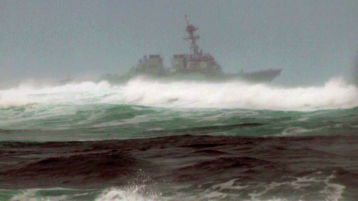 RETRANSMIT FOR IMPROVED TONING - A search vessel cruises the waters off the beach at Haleiwa, Hawaii, Friday, Jan. 15, 2016. Two Marine helicopters carrying 12 crew members collided off the island of Oahu during a nighttime training mission, and rescuers are searching a debris field in choppy waters, military officials said. (AP Photo/Audrey McAvoy) ORG XMIT: AZTS103