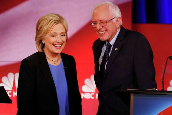 Democratic presidential candidate, Hillary Clinton and Democratic presidential candidate, Sen. Bernie Sanders, I-Vt. smile during a break of the NBC, YouTube Democratic presidential debate at the Gaillard Center, Sunday, Jan. 17, 2016, in Charleston, S.C. (AP Photo/Mic Smith) ORG XMIT: SCML150