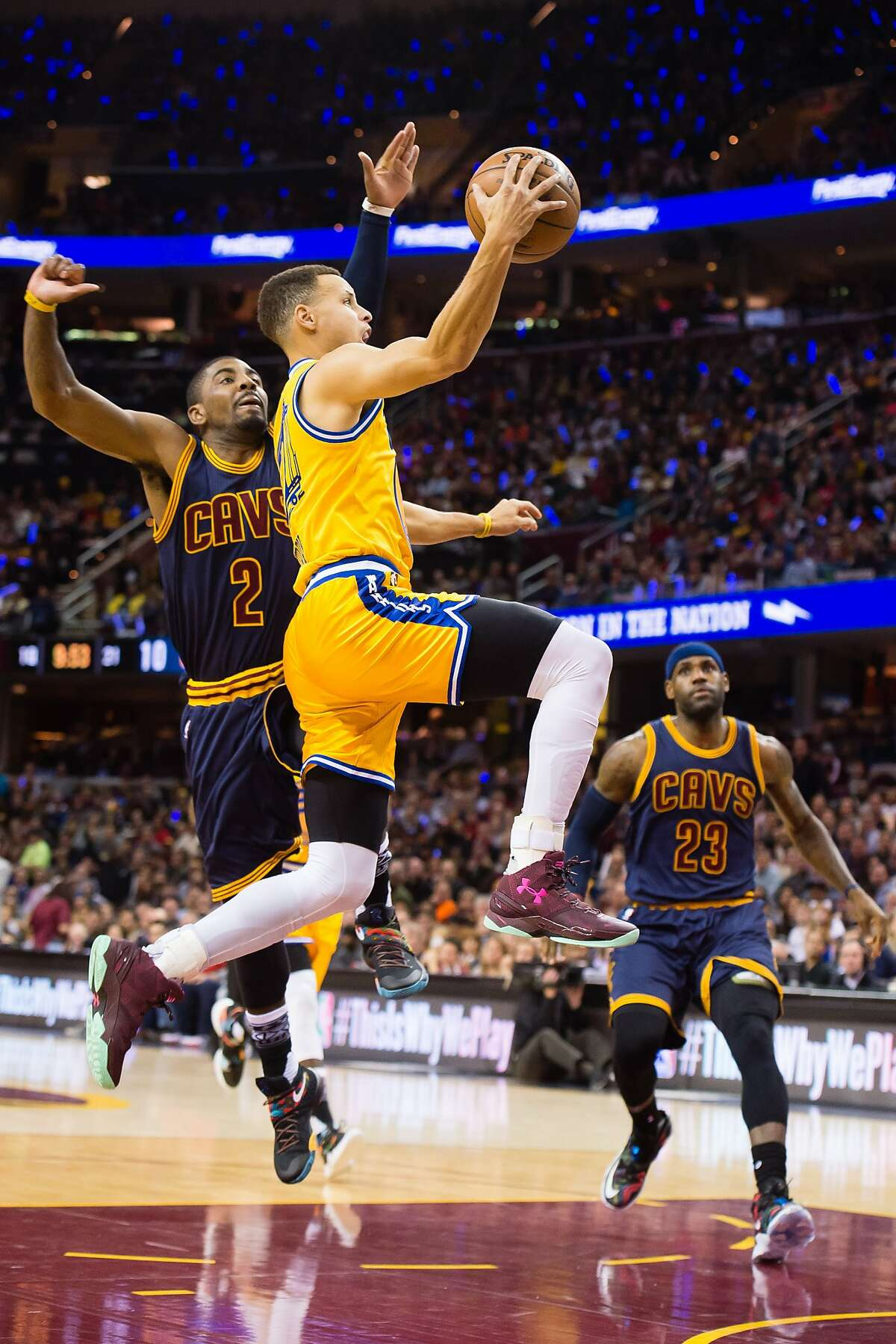 Stephen Curry #30 of the Golden State Warriors shoots over Kyrie Irving #2 and LeBron James #23 of the Cleveland Cavaliers during the first half at Quicken Loans Arena on January 18, 2016 in Cleveland, Ohio.