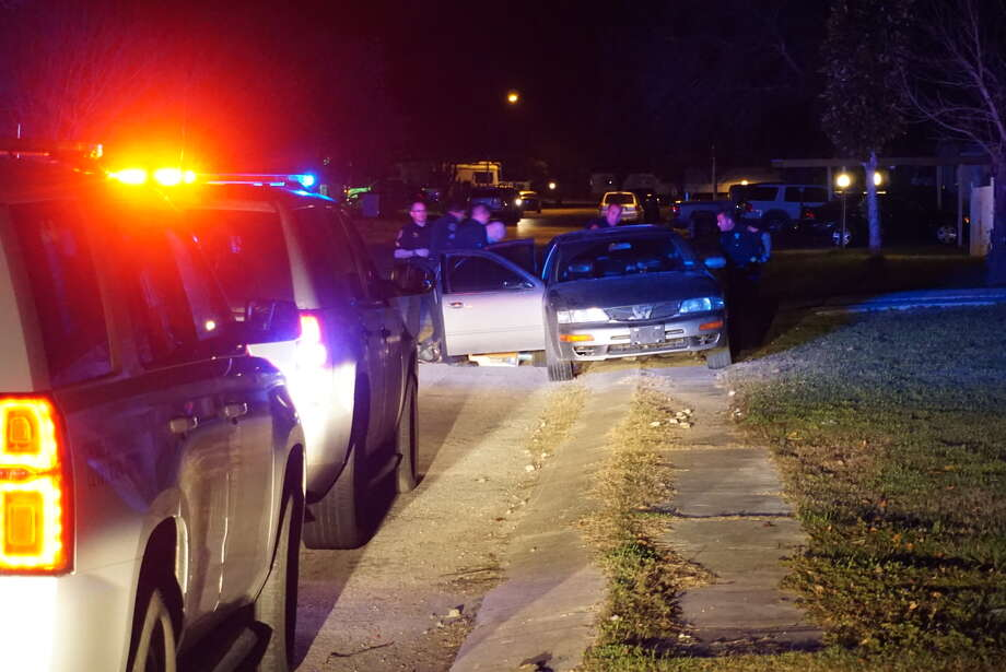 A man was arrested and multiple firearms recovered after a chase beginning in Losoya reached 100 mile-per-hour speeds ended Monday night in a Southeast Bexar County subdivision. Photo: Jacob Beltran