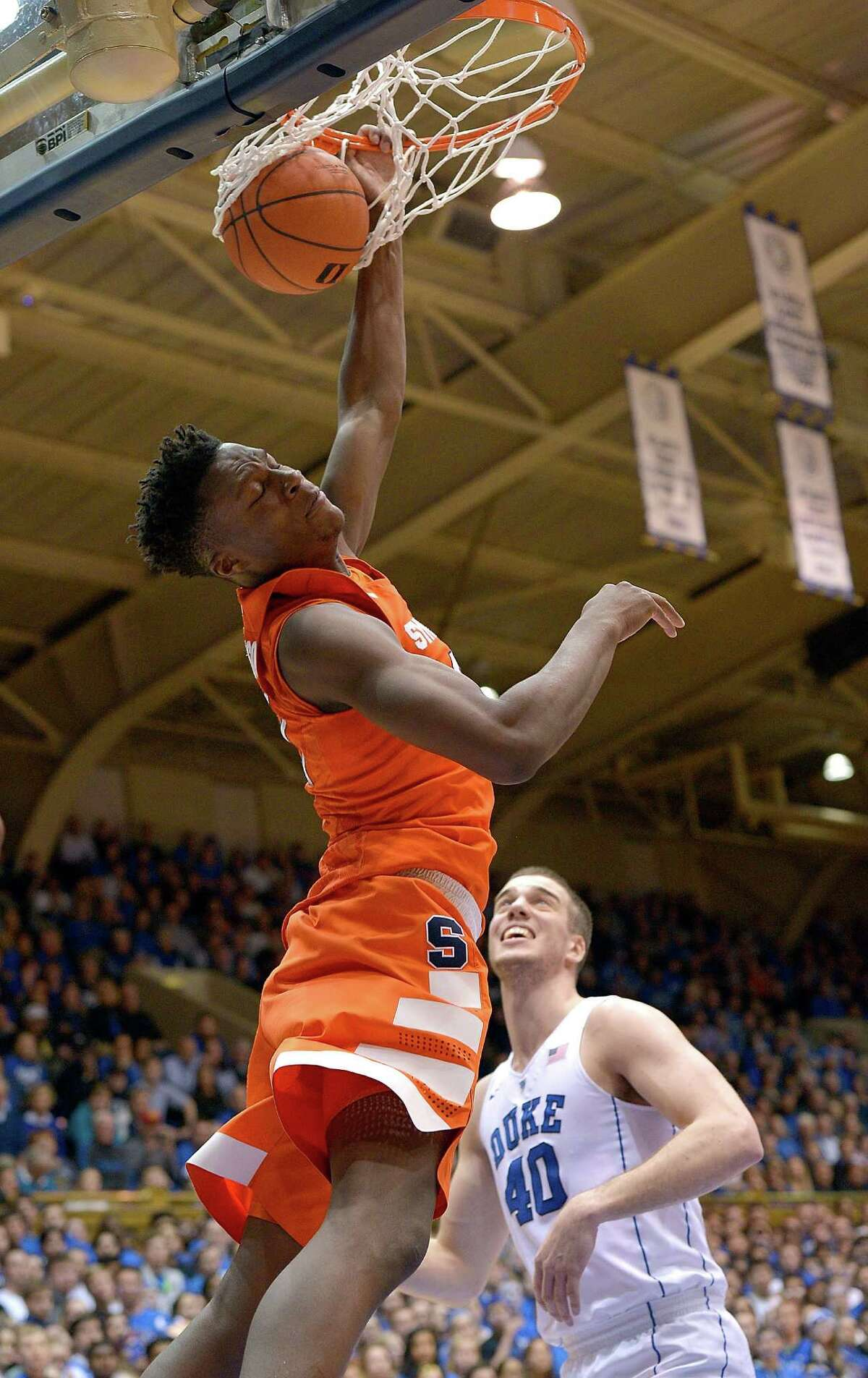 DURHAM, NC - JANUARY 18: Tyler Roberson #21 of the Syracuse Orange dunks over Marshall Plumlee #40 of the Duke Blue Devils during their game at Cameron Indoor Stadium on January 18, 2016 in Durham, North Carolina. (Photo by Grant Halverson/Getty Images) ORG XMIT: 587451755