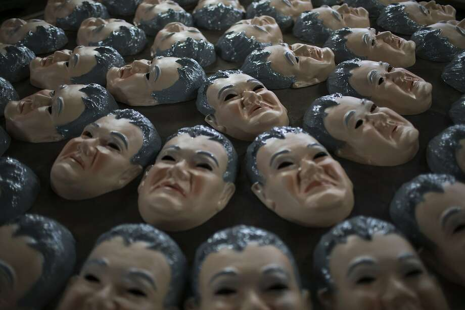 Carnival masks in likeness of Federal Police officer Newton Ishii sit to dry at the Condal mask factory, well known for its clever designs featuring politicians or other news makers, in Sao Goncalo, near Rio de Janeiro, Brazil, Monday, Jan. 18, 2016. Ishii became a social media sensation after he was photographed several times detaining politicians and executives in the corruption scandal engulfing state-owned oil company Petrobras.  Photo: Felipe Dana, Associated Press