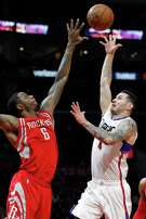 Clippers guard J.J. Redick, right, shoots a runner over Terrence Jones during his 40-point game.
