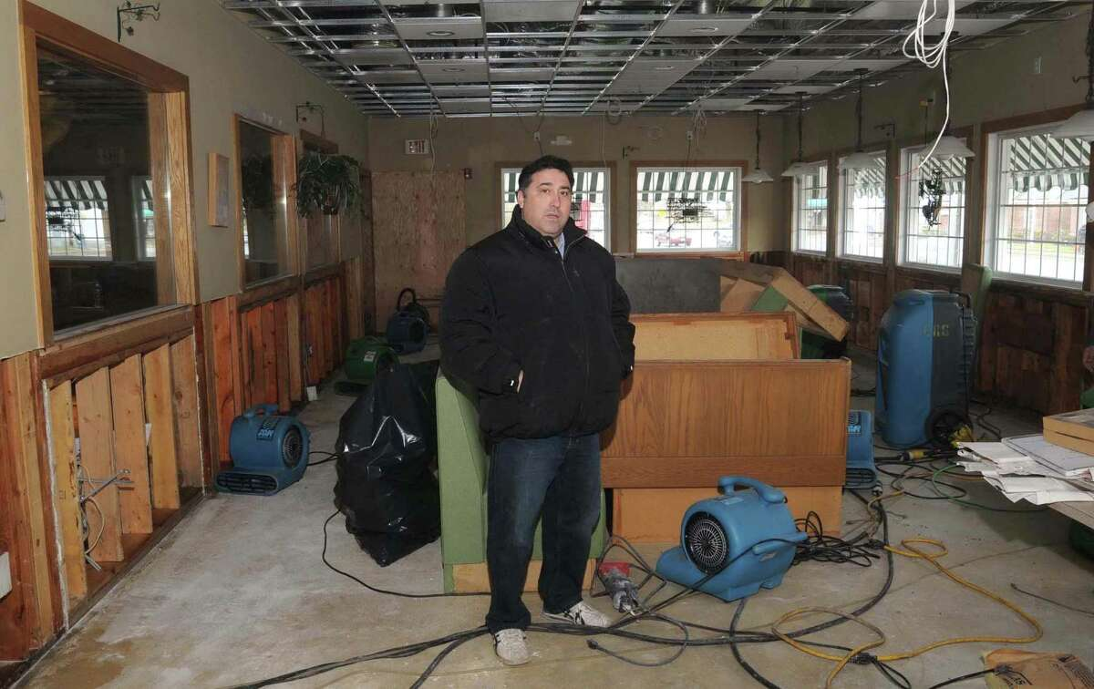 Tony Fernandes, stands in the dining room of Tonelli's Restaurant, in Bethel, Conn., which was closed because of water damage on Jan. 20, 2010.