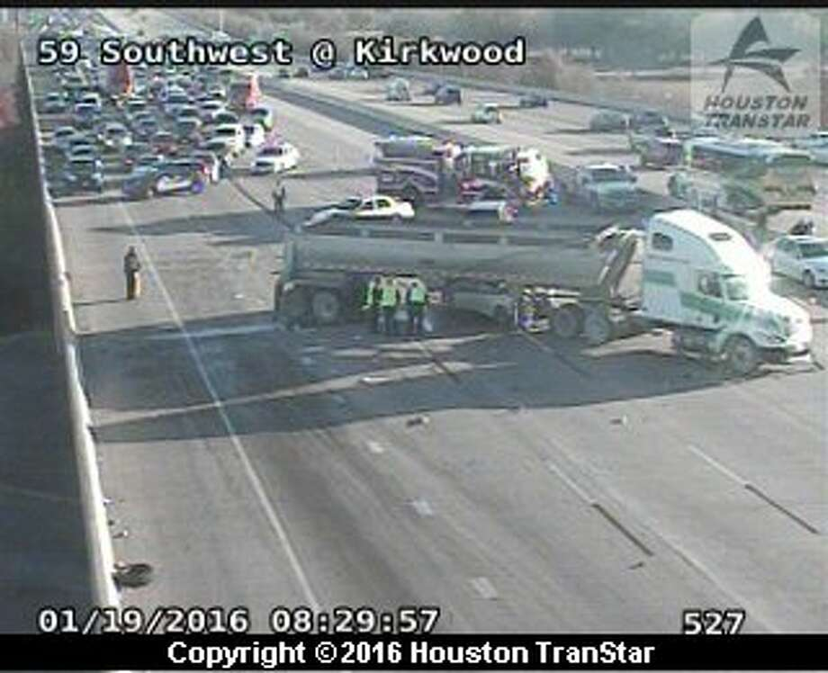 A big-rig crash blocked outbound Southwest Freeway near Kirkwood about 8:20 a.m. Tuesday. Photo: Houston TranStar
