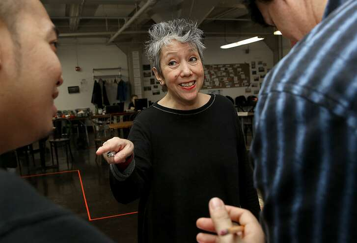 """Playwright Jessica Hagedorn (middle) works with actor Melvign Badiola (left) and stage manager Kevin Johnson (right) during a rehearsal of """"Dogeaters"""" at Fort Mason in San Francisco, California, on Thursday,  January 14, 2016.  ÒDogeatersÓ has its San Francisco premiere at the Magic Theatre at Fort Mason next month."""