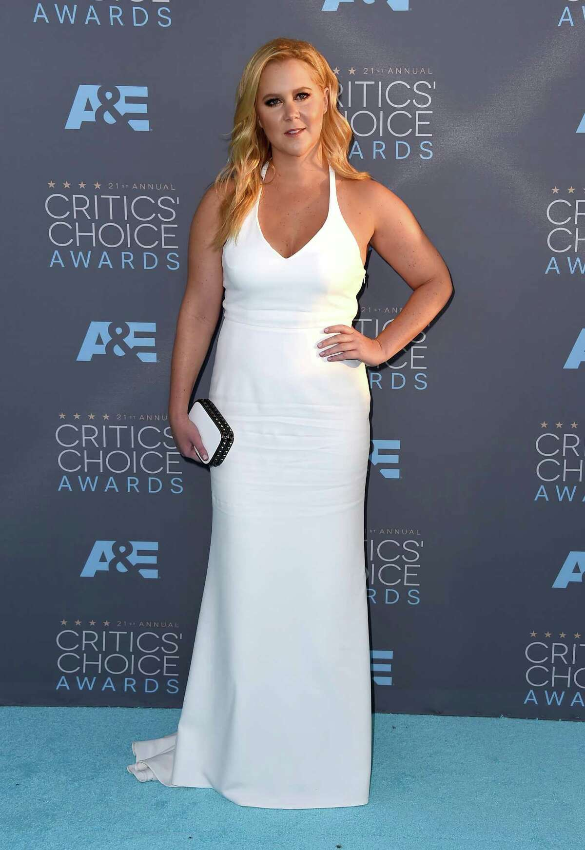 Amy Schumer arrives at the 21st annual Critics' Choice Awards at the Barker Hangar on Sunday, Jan. 17, 2016, in Santa Monica, Calif. (Photo by Jordan Strauss/Invision/AP) ORG XMIT: CACJ169