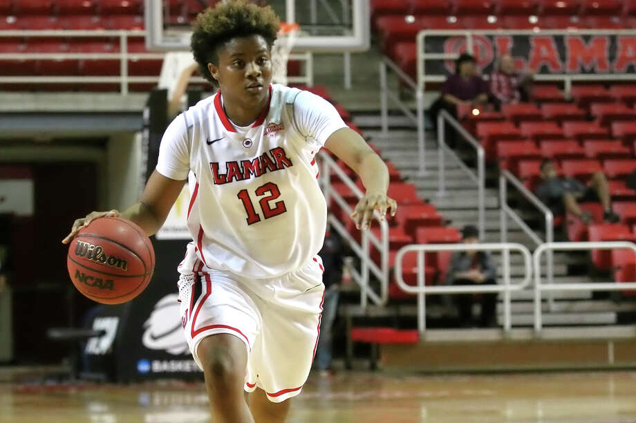 Kiara Desamours looks to drive to the basket during the game between the Lamar Cardinals and Texas A&M University-Kingsville Javelinas at the Montagne Center Thursday, December 17th, 2015  - photo provided by Kyle Ezell