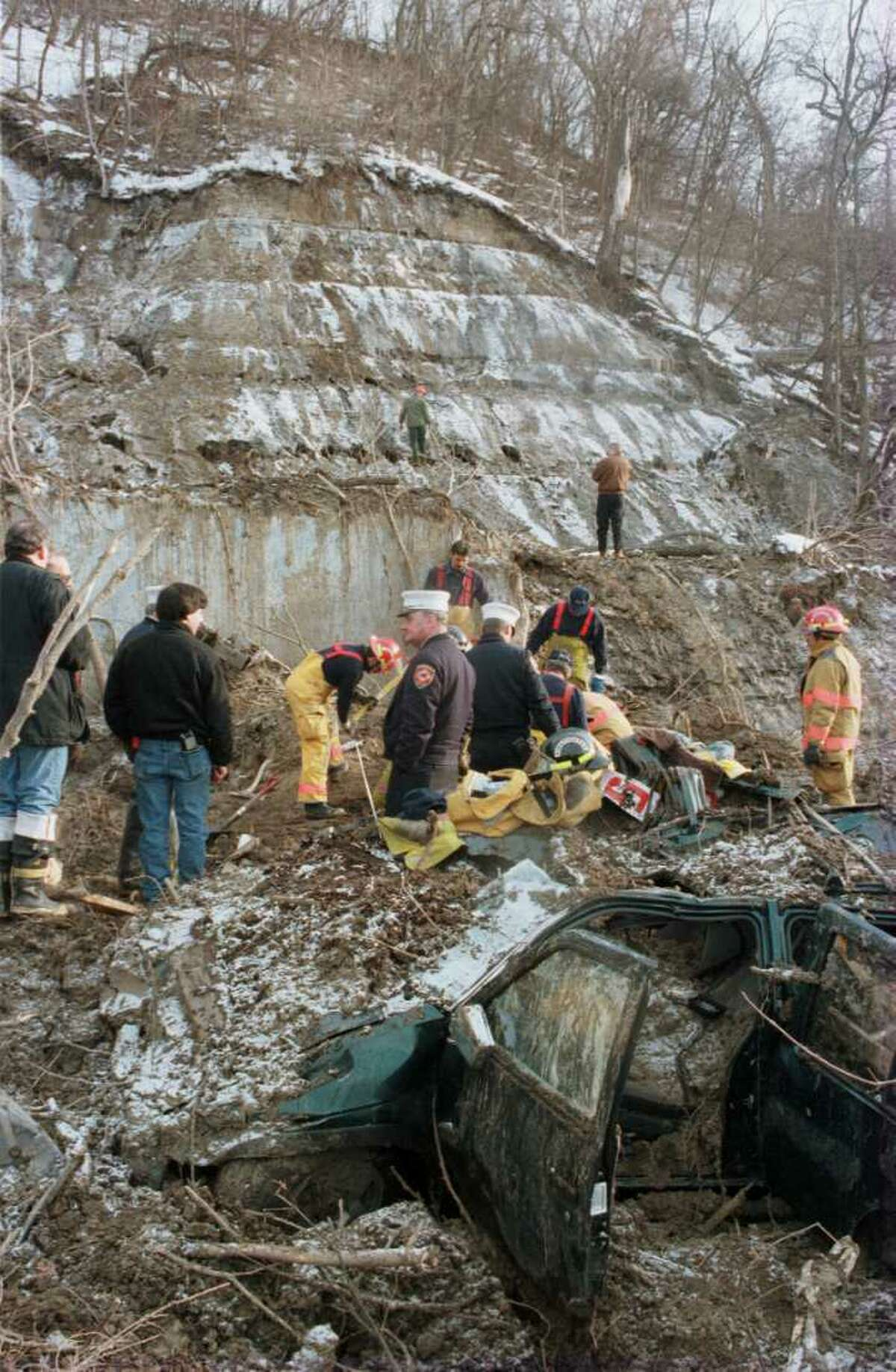 Schenectady firefighters and rescue personnel dig for further evidence and possible victims at scene of Broadway mudslide on Monday Jan. 22, 1996, in Schenectady, N.Y. (Jack Madigan/Times Union archive)