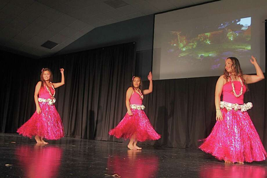 The grand opening for World Theater, a  Katy venue promising fine arts performances, included dance from various cultural traditions. The dance group, Tropical Rhythm, featuring Cherry May Stefura, left, Grace Holmes and Jessyle Payne, performed a hula. Photo: Suzanne Rehak, Freelance Photographer