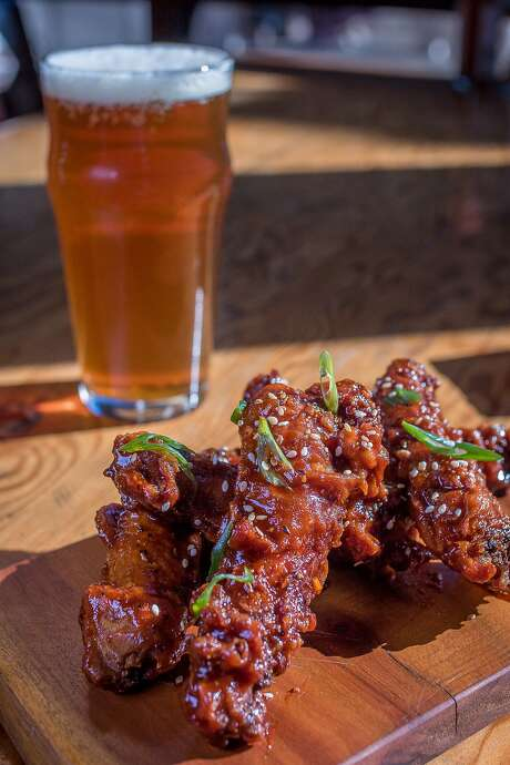 Korean Fried Chicken Necks with a House IPA by Berryessa Brewing at the Half Orange in Oakland. Photo: John Storey, Special To The Chronicle