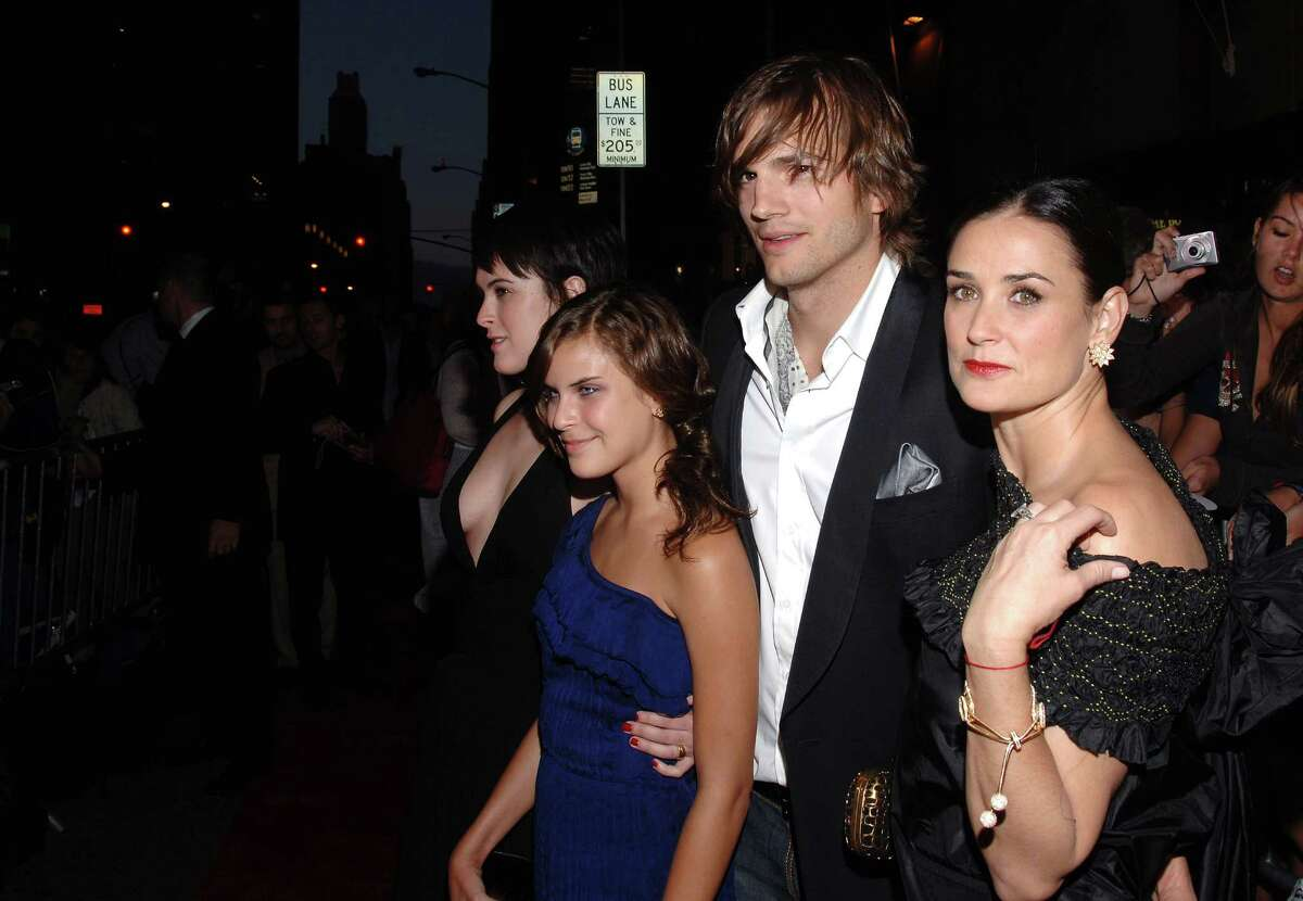 Actors Ashton Kutcher and Demi Moore pose with her children Rumer and Tallulah Belle Willis at the premiere of