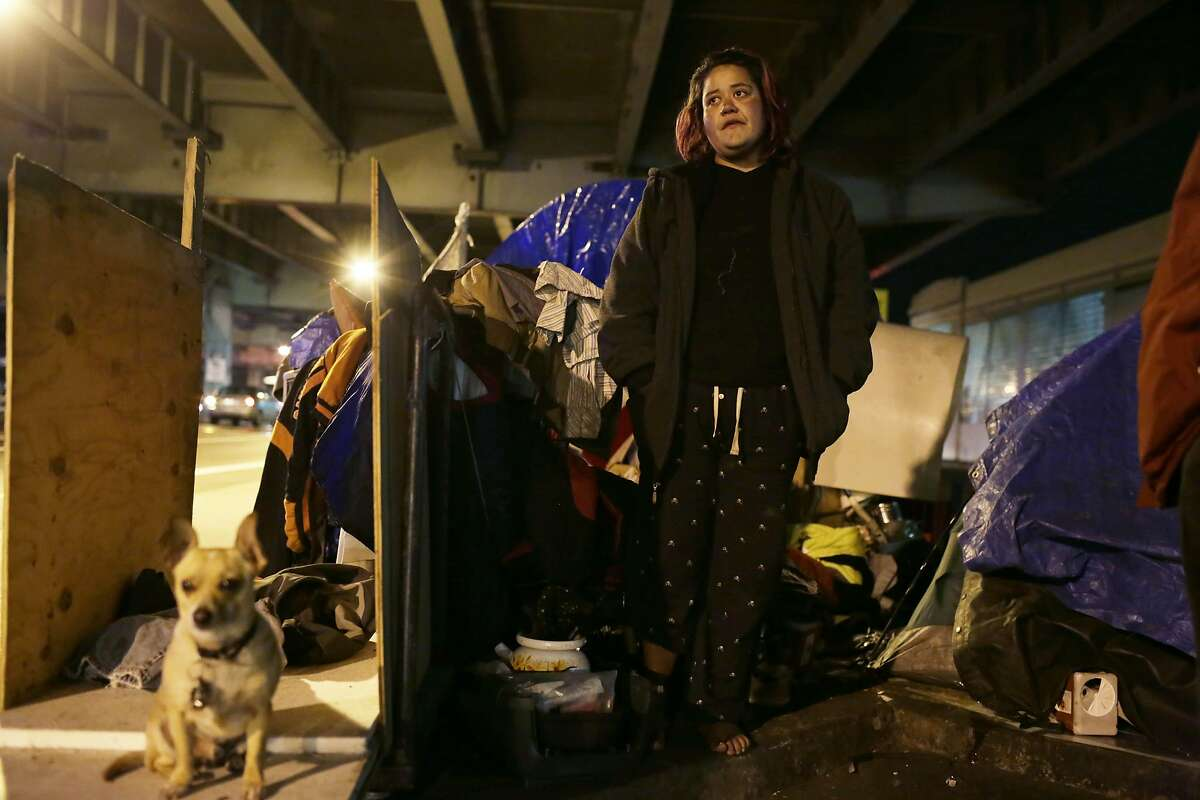 Debra Lujan stands outside her tent on 13th Street in the evening of Tuesday, January 12, 2016 in San Francisco.