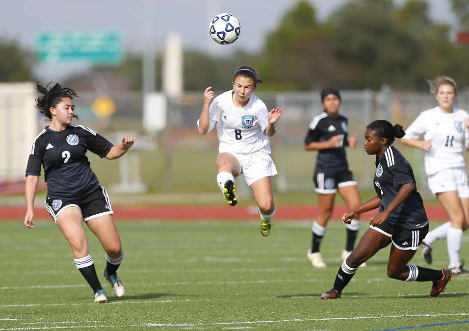 Cat Childs of Kingwood gets a jump on on the ball in between Clear Springs defenders Christina Hildago and Lauryn Rutherford in the opening round of the 2016 I-10 Shootout Soccer Tournament last weekend. Photo: Diana L. Porter, Freelance / © Diana L. Porter