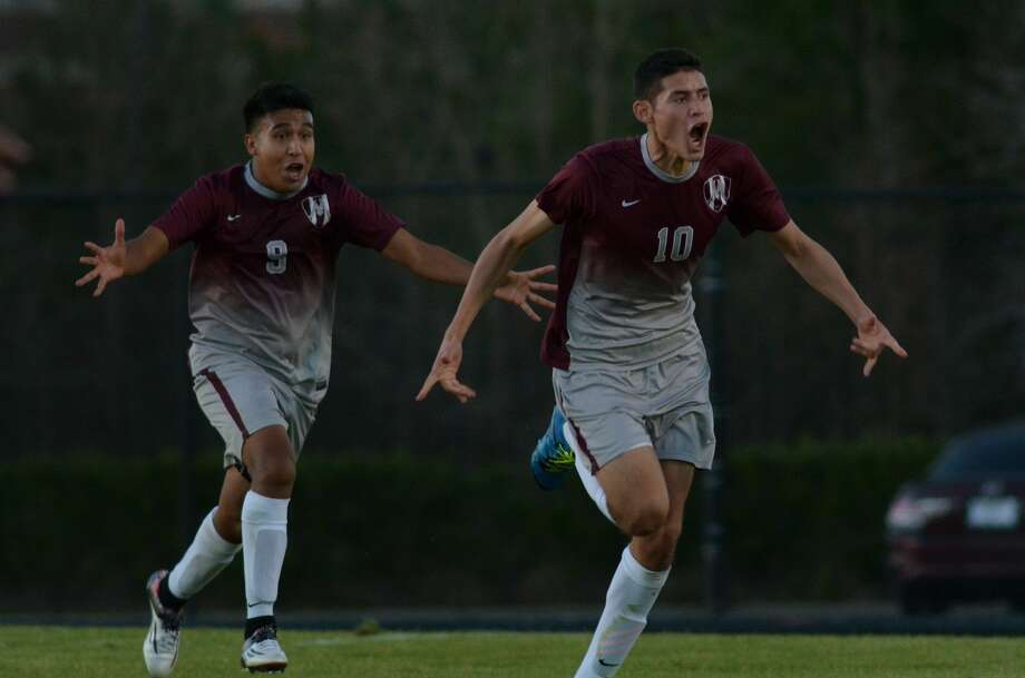Magnolia's Oscar Aragon (10) celebrates his winning goal with teammate James Del Angel (9) against College Park during the Bulldogs' 3-2 win last week. Photo: Jerry Baker, Freelance