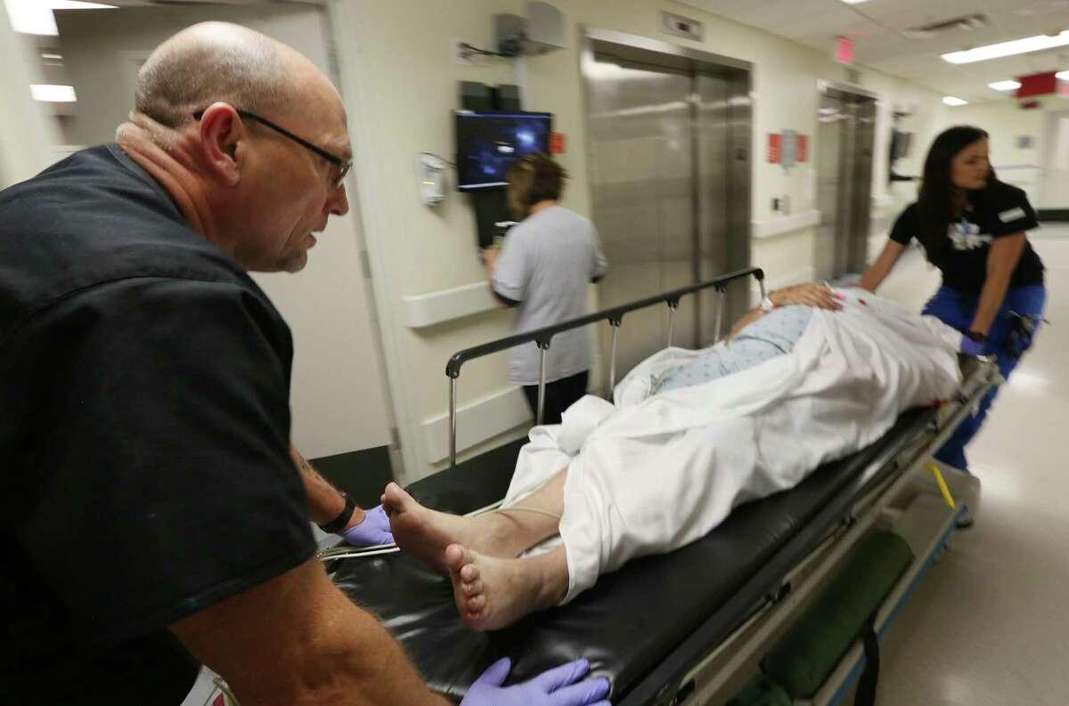 Gary Cromer wheels a trauma patient into the emergency room at Ben Taub Hospital, a Trauma One Facility.