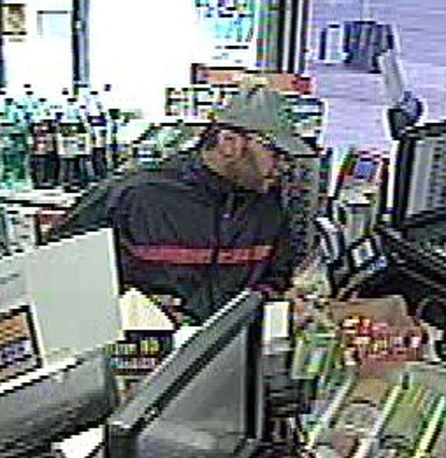 San Antonio police are searching fro a man suspected of robbing a Valero convenience store on the South Side in December. Photo: San Antonio Police Department