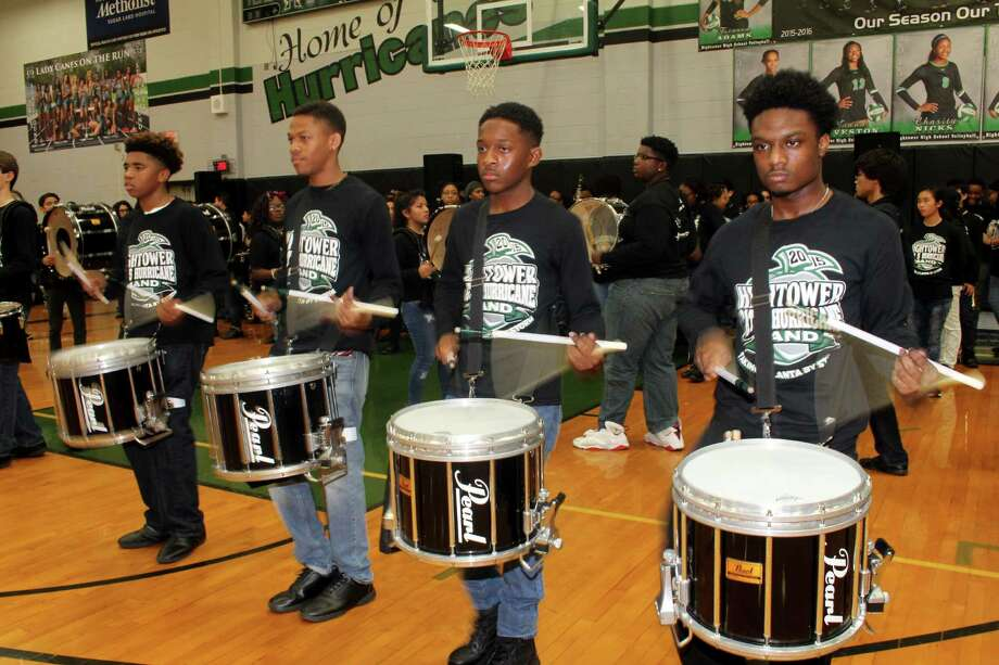 Hightower High School Band snare drummers Jaylen Davis, Demondre Newson, Evan Gautier and Tre Murray keep the beat at a school pep rally. Gautier, who has been ranked in the top 10 in the state for the past two years, wasn't zoned to Hightower but ended up at the high school because of its academies and a desire to participate in the Hightower band.  Photo: Suzanne Rehak, Freelance Photographer