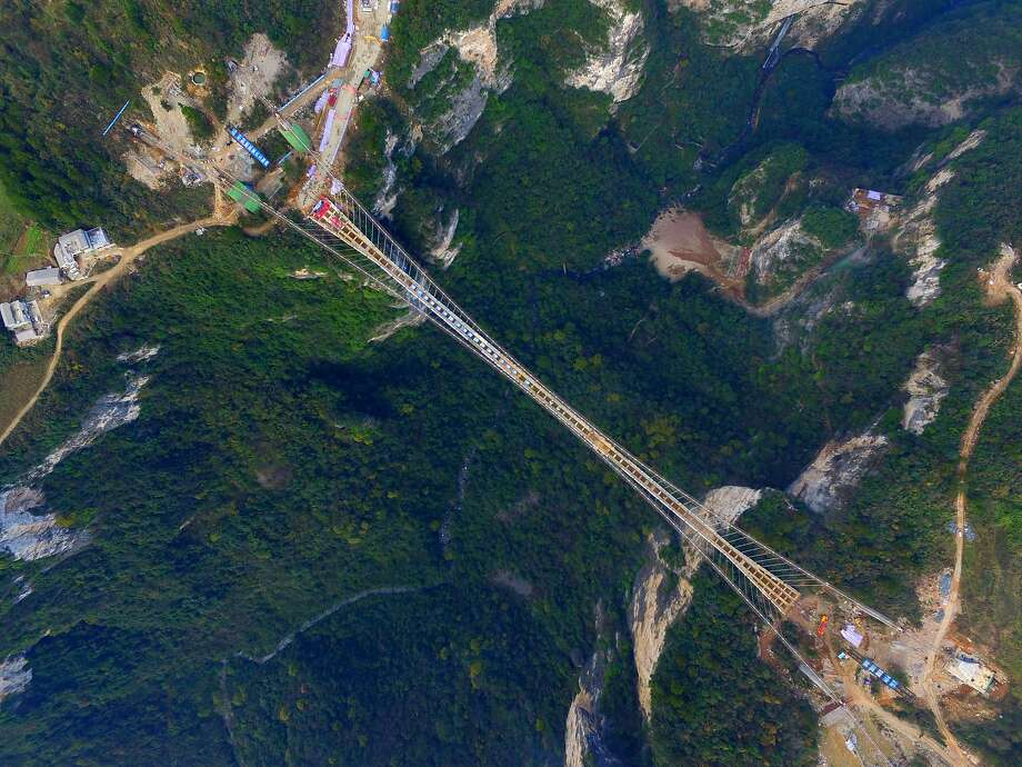 Aerial view of the glass-bottom suspension bridge under construction at Tianmenshan National Forest Park in Zhangjiajie, Hunan Province. Photo: ChinaFotoPress
