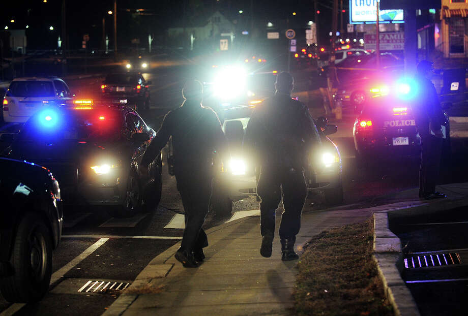 Police cars block off access to  Bayview Plaza on Boston Avenue in Bridgeport, Conn. as state police investigate a double shooting by a Bridgeport police officer in the plaza parking lot on Monday, November 25, 2013. Photo: Brian A. Pounds / Brian A. Pounds / Connecticut Post